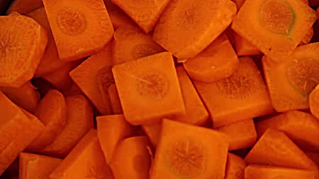 chop up : Close-Up On Bowl Of Carrots Diced, Slice Carrots In The Background