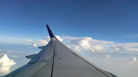 transportado pelo ar : Impressive Aerial View From Airplane Window On Air Plane Wing Flying High Over Vídeos