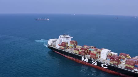 ithalat : Top View Of A Cargo Ship Loaded With Containers Moving On Water.