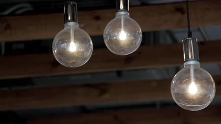 filamento : Lightbulbs Moving in the Wind Stock Footage