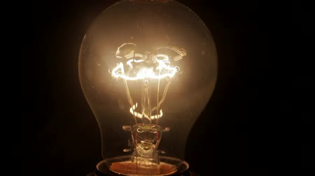 filamento : A lightbulb goes on and off again. Stock Footage