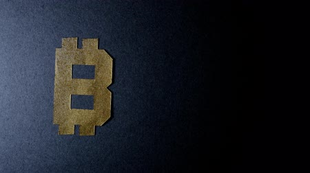 single shot : Bitcoin Symbol On A Black Background