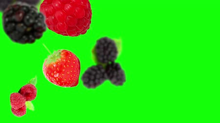 взбитые : Falling Strawberries on green background