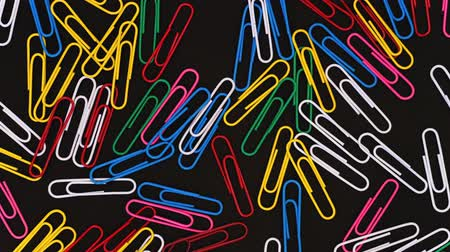 зажим : Closeup Macro Shoot Of paper clips in motion