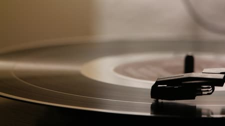 retro revival : a close up shot of a vinyl record playing on a turntable Stock Footage