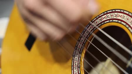 strum : Closeup On Hand Strumming At Acoustic Guitar Strings