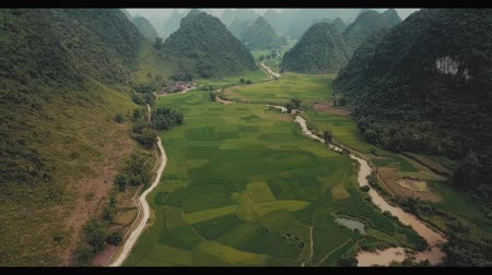 chmury : Flying Above Rice Fields With Mountains Around