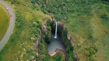 montanhas rochosas : Big Waterfall From High Above In Jungle Stock Footage