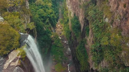 turisták : Big Waterfall From High Above In Tropical Jungle Stock mozgókép