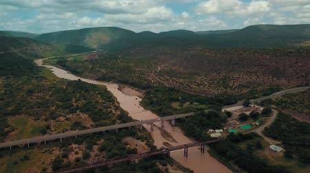 powódź : Aerial footage Of A Bridge Through River On A Mountain Valley