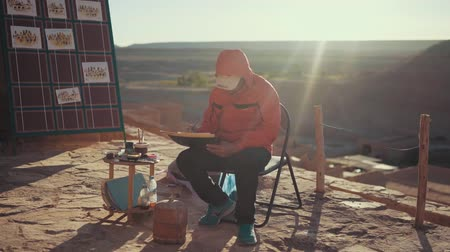 adam : Static Footage Of Artist Painting Landscape Painting. Morocco Stok Video