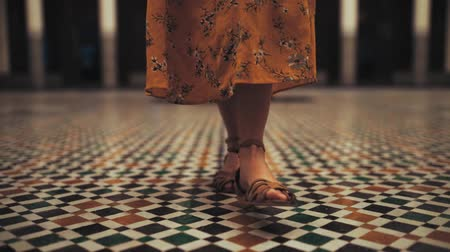 modelka : a woman walks on mosaic in morocco
