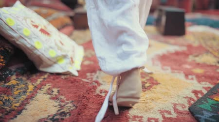 cipő : Male Feet In Sport Shoes Walking On Carpet in morocco Stock mozgókép