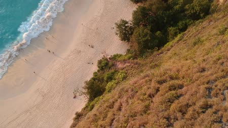 cerceta : Aerial Of People Enjoying the Beach In Indonesia