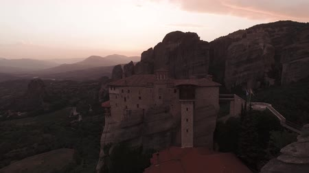православие : Aerial View. Dynamic Flight Over Monastery On Top Of High Cliff In Meteora. Стоковые видеозаписи