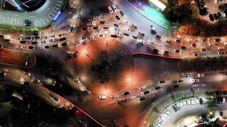 paisagem urbana : Aerial Fix Shot Of Roundabout City Traffic. Top View. Banten, Indonesia Vídeos