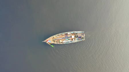 vessels : Drone Shot While Lifting Straight Up Looking Down On A Person In A Boat Stock Footage