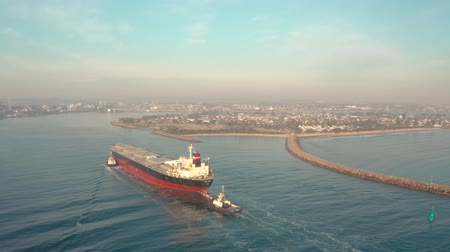 vessels : Aerial Shots Of Cargo Container Ship Entering Newcastle Harbour. Australia Stock Footage