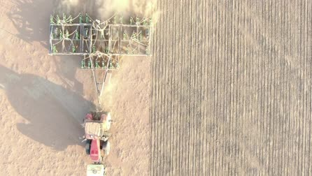 gleba : Tractor Plowing Dry Land. Aerial Footage Wideo
