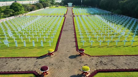 perspektif : Flying Over White Crosses At Dutch War Memorial Site Jakarta, Indonesia