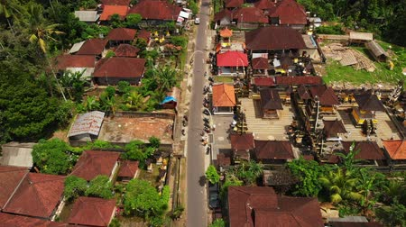 паром : Aerial View Drone Flight Over Red Roof Houses . Tropical Bali Island. Indonesia.