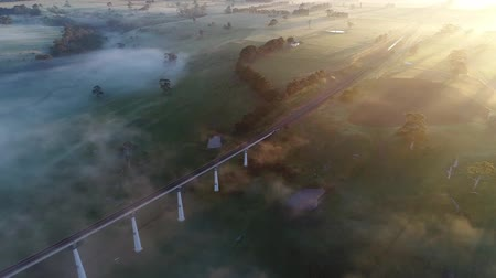 dojíždění : Aerial Of Electric Train Running On A Railway Track On A Foggy Day