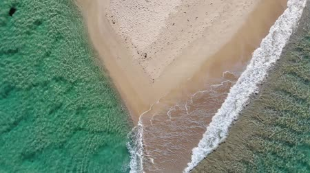 rohanó : Aerial Drone Footage Of Waves Rushing the Beach. australia Stock mozgókép