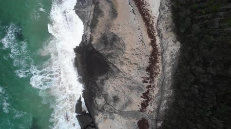 indianin : Aerial View Of Ocean And Waves Breaking On Rocks On The Beach Near Cliff. Australia Wideo