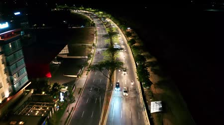 felhőkarcolók : night Drone Shot Flying Above The Busy Highway Traffic In Banten. Indonesia Stock mozgókép
