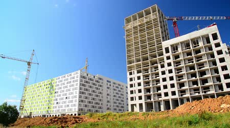 high rises : Construction of houses of different architecture in Moscow, Russia Stock Footage