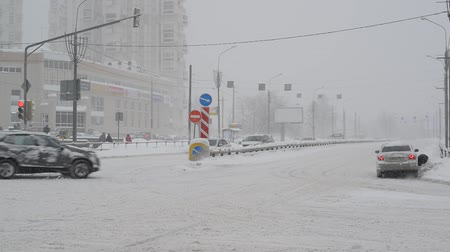 road sign : Moscow, Russia - February 4. 2018. Traffic on road after heavy snowfall in Zelenograd