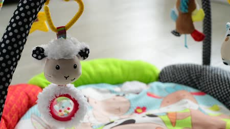suspension : toys for newborns hang over rug