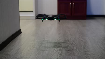 laminát : The quadrocopter soars up in room