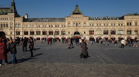cobbles : Moscow, Russia - April 14. 2018. People are walking on Red Square along Gum store