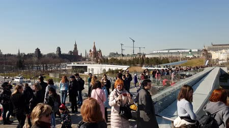 observation deck : Moscow, Russia - April 14. 2018. people on flying bridge in park Zaryadye Stock Footage