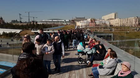 observation deck : Moscow, Russia - April 14. 2018. People in a viewing platform in park Zaryadye Stock Footage