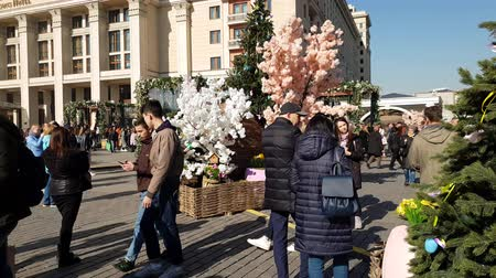 gif : Moscow, Russia - April 14. 2018. People are walking in Manege Square during festival Easter gift