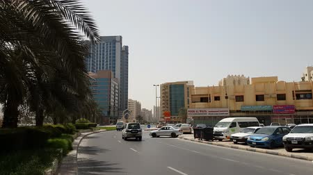 road sign : Ajman, UAE - April 11. 2018. Typical cityscape with road
