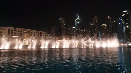 khalifa : Dubai, UAE - April 8. 2018. musical fountain on Burj Khalifa lake at night