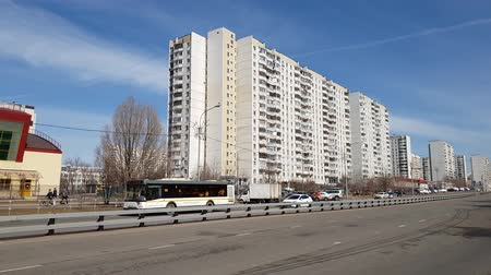administracja : Moscow, Russia-April 22.2018. Various vehicles are traveling along road in background of houses