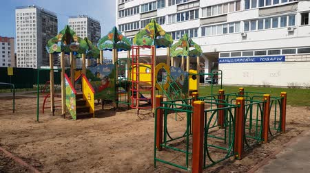 nem városi színhely : Moscow, Russia-April 24.2018. childrens playground with drawings in third microdistrict in Zelenograd Stock mozgókép