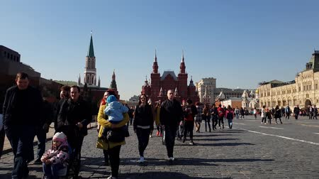 cobbles : Moscow, Russia - April 14. 2018. tourists are walking on Red Square along Gum store