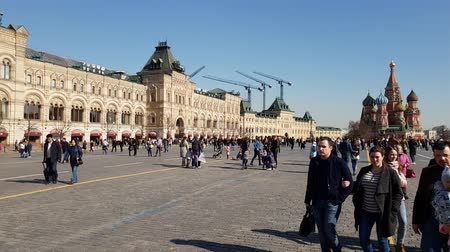 camera move : Moscow, Russia - April 14. 2018. tourists are walking on Red Square along Gum store