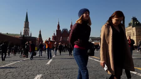 cobbles : Moscow, Russia - April 14. 2018. tourists are walking on Red Square