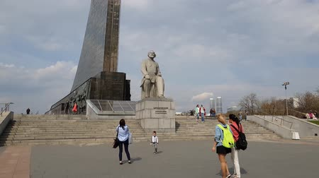 conquerors : Moscow, Russia - April 30. 2018. People are walking near monument to Tsiolkovsky