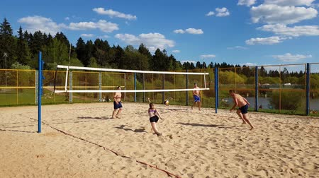 volleyball : Moscow, Russia - May 08. 2018 people play beach volleyball in city park in Zelenograd Stock Footage