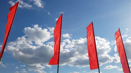 ensign : Red flags swaying in wind against the blue sky. Stock Footage