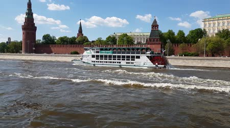 assumption : Moscow, Russia - May 12. 2018. Ship with paddle wheelsail on river past Kremlin