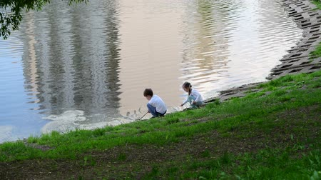 sobre : Moscow, Russia - May 15. 2018. Children playing near the pond in 15th district of Zelenograd Stock Footage