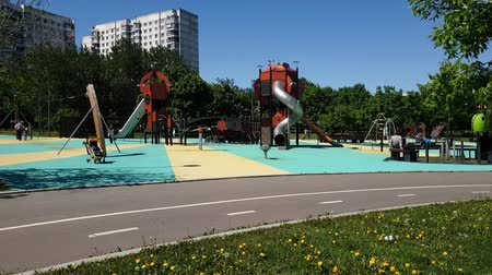 wood glade : Moscow, Russia - May 22. 2018. playground for children in Park Sadovniki in Southern Administrative District Stock Footage